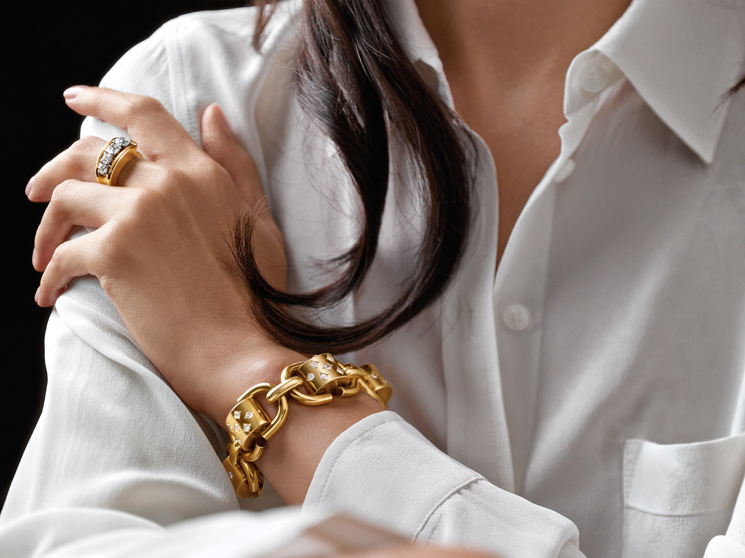 Photography of jewelry on model - yellow gold bracelet